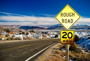 Road sign: Rough Road 20 Miles per Hour