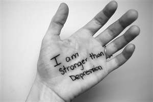 Left hand with writing: I am stronger than Depression