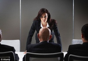Woman facing down a man in the boardroom