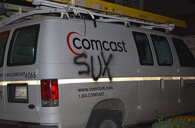 Van with Comcast Sux on it