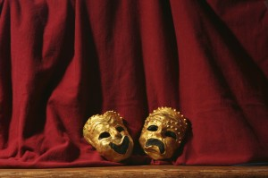 Comedy and Tragedy Masks on a Stage