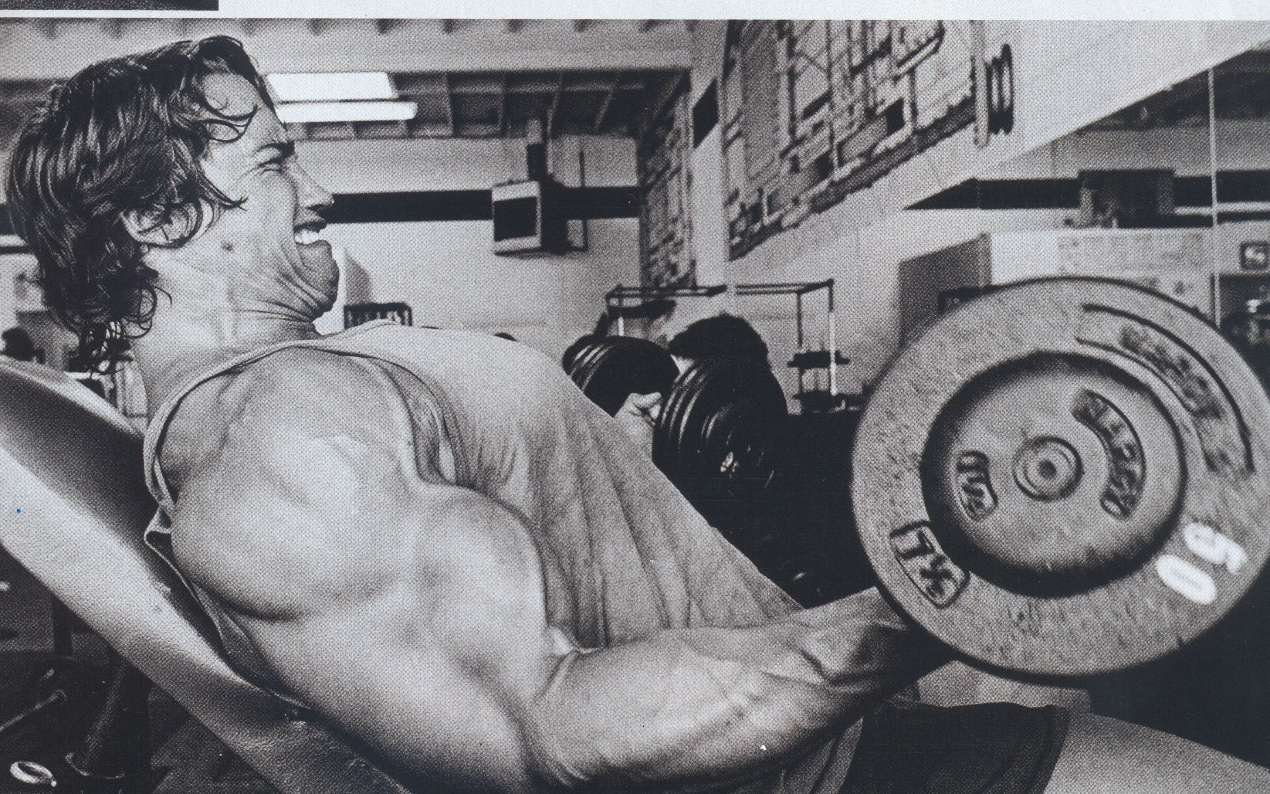 Arnold Schwarzenegger lifting weights