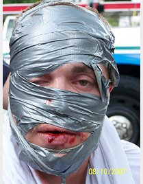 Man's face covered in duct tape