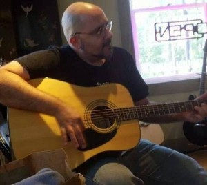 Bill Playing Guitar
